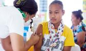 Samoan girl receiving a vaccine
