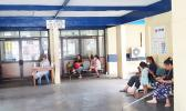 Mothers and children waiting at a hospital in Apia.