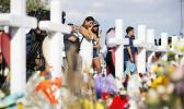 People visit a makeshift memorial in El Paso, Texas