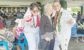 Mrs. Vera Annesley (center) and two of the several Elvis impersonators that were hosts at the event —(left) Joey Cummings of KHJ Radio and (right) Tui Letuli, a board member of both SMF and SJAAS