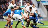 Ellis Genge tries to find a route through for England under heavy pressure from the blue-shirted Samoans [Reuters via Daily Mail]
