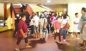 Crowds of people inside the EOB