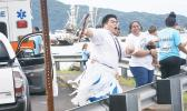 Sean Tilo and his sister Sherry cheering and dancing for their village fautasi, the Aua Paepaeulupo'o during the second heat at yesterday's fautasi regatta for the 2017 Annual Flag Day Fautasi Faigamea i le Tai. The boat came in first in heats overall with a time of 35:19.13. The Championship Race is not set for Saturday. [Photo: EM]