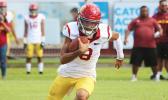 Tafuna Warriors quarterback Oakland Salave'a scrambling