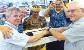 "Local government staff, including Fa'aui Fano Lefotu, prepared a farewell luncheon Wednesday afternoon for US Federal Emergency Management Agency (FEMA) officials, as the Disaster Recovery Center, located inside the DYWA Pago Pago Youth Center, officially closes tomorrow.  Pictured are two FEMA officials, with local staffers, cutting the cake — which read ""Thank You FEMA."" Local government officials, who assisted FEMA officials with translations and other duties prepared the delicious cake. [photo: Leua Aio"
