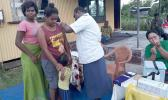 Woman receives a measles vaccination in Fiji