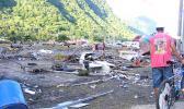 Residents at Pago Pago Park amid debris