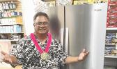 Talavave Maae with the Whirlpool refrigerator he won.