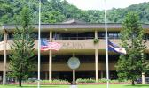 Flags in front of the EOB at half staff