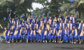 Fa'asao Marist High School 2020 graduates throwing caps in the air