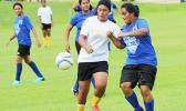 Jordynn Liu-Kuey of Fa'asao-Marist (left) in action against a Samoana defender during