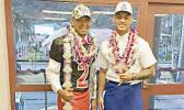 Steven Fiso (left) of Faga'itua High School who signed on with the University of Hawaii, and Eddie Siaumau (right) of Fa'asao Marist High School who signed with the University of Arizona.