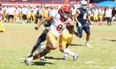 Tafuna Warriors quarterback Oakland Salave'a scrambling through midfield