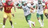 Pearson Livi of the Leone Lions focus on timing his stiff arm