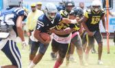Samoana Sharks quarterback Viliamu Tanielu stiff arms a Nu'uuli Wildcat defender