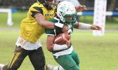 Freshman running back for Leone, Wylan Faga is tackled