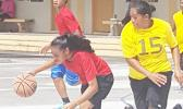 Dorvida Fuiava dribbling away as Leata Seumanu tries to stop her during a match-up between the yellow team and red team at last Saturday's basketball showdown in Malaeimi. [Courtesy photo]