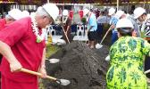Gov. Lolo Matalasi Moliga, Police Commissioner Le'i Sonny Thompson, along with ASG officials turning the first shovels of dirt at ground breaking.