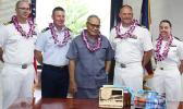 Gov. Lolo Matalasi Moliga (center) with Commander Andy Strickland, Commanding Officer of the USS Shoup; two Naval officers and a US Coast Guard official