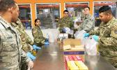 New York Army and Air National Guardsmen pack food parcels at Feeding Westchester, a food pantry in Westchester County, N.Y.