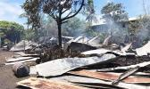 roofing iron smoldering and spread around on the ground