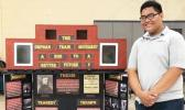 "Koneferinisi Purcell of Manumalo Academy with his project ""The Orphan Train Movement: A Ride to a Better Future?"""