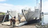 A landing craft being used for commercial purposes