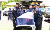 American Samoa flag draped casket of the late former Sen. Tulifua Tini Lam Yuen with police escorte