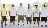 Lions coaching staff led by Head Coach Okland Salave'a (center) posing for a group photo just before practice. Salave'a is the former head coach for the Tafuna High School football program — leading them to a '3-peat' football championship, a THS record. However, last year, the Vikings defeated the Warriors stopping THS' dreams of a 4-peat record.  [photo: TG]