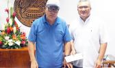 Gov. Lolo Matalasi Moliga in a photo from Tuesday, July 23, 2019 with Monsignor Viane Etuale
