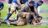 Muddy conditions on the field during Samoa vs Tonga rugby match
