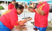 Department of Marine and Wildlife Resources staff weighing and measuring fish