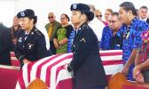 Former Rep. Matagi's flag drapped casket being carried into funeral service