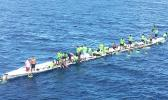 The Matasaua crew awaiting help to arrive after their fautasi took on water last Saturday