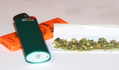 Marijuana buds, rolling papers and lighter