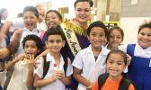 Reigning Miss American Samoa, Magalita Johnson with students.