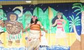 "American Samoa's very own ""Moana"" — standing in front of classroom doors painted with the likeness of Disney's Maui and Moana"