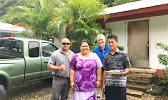 Mrs. Asoiva Togafau (center), with John and Ricky Leulu (far right)