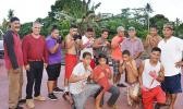 Seen here are local boxing officials with some of the new boxers, who may just fulfill their dreams of becoming future champions for American Samoa. See story for full details.  [photo: AF]