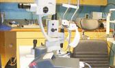 The new YAG laser (left on the table) as well as the eye examination/procedure chair seen last Thursday afternoon the LBJ Medical Center's Eye Clinic.  [photo: FS]