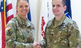 Cpt. Carneen Cotton (left) shaking hands with Capt. Timothy Shea
