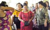 Luse Emo Tauvale (center wearing the red puletasi) leaves the courthouse in Apia last year