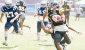 Joe Savaii of the Nu'uuli Wildcats turning on his boosters and beating another Samoana Shark defender to the punch line