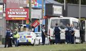 Police stand outside a mosque in Linwood, Christchurch NZ