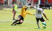 Maro Bonsu-Maro charging up for his third goal of the match as Veitongo FC goalie Sione Uhatahi reacts to defend a hat-trick that came in the second half of their 9-2 victory over Tonga this past Tuesday. All tourney games are played at the Pago Soccer Field. [photo: TG]