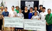 Students of Onnuri Piano Academy — together with members of American Samoa's Korean and Chinese Associations, and the Korean and Chinese Community Youth Groups — pictured with two checks