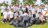 Manumalo Academy students with bags of rubbish collected from Pala Lagoon area