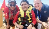 Alofaeleuma Faualo (center) with his crew 11-year old Laser Sailor Carneal Lili'o Satele and Tony Greubel, Charge de Affaires for the US Embassy