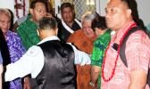 Prime Minister Tuilaepa surrounded by Samoans