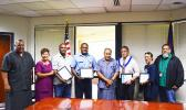 [l-r] Lt. Gov. Lemanu Palepoi Sialega Mauga, Port Administration director Taimalelagi Dr. Claire Poumele, Port employee Sunia Davetawalu, Port employees Timoci Loloma, Gov. Lolo Matalasi Moliga, Harbor Master Silila Patane, Port employee Joseph Fa'agata, and Port Administration deputy director Chris King, yesterday morning at the Governor's Office Conference room at the conclusion of a brief recognition ceremony. (See story inside for details of the quick actions of the 3 Port employees that saved Patane's